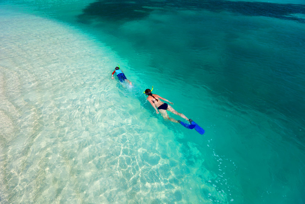 Dive into new caledonia international traveller magazine for The caledonia