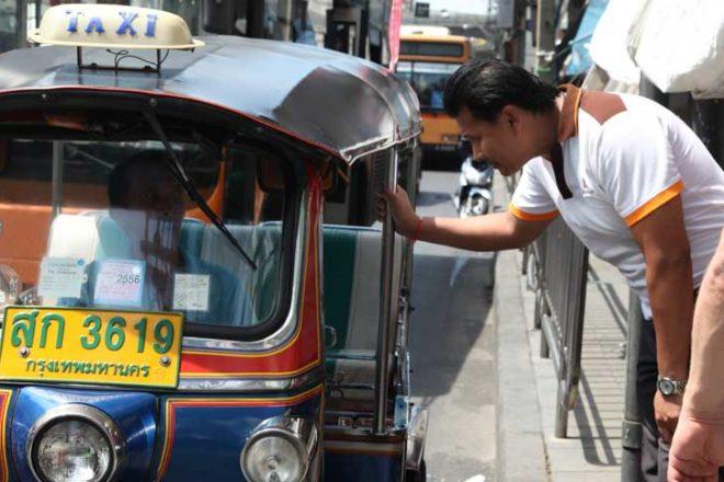 Your Bangkok friend Chetta negotiates with a tuk tuk driver