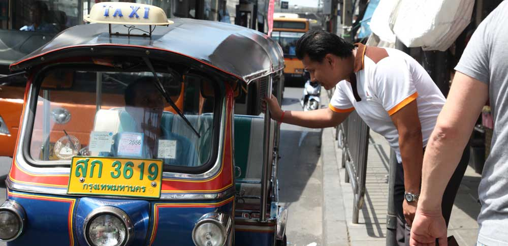 Your Bangkok friend Chetta negotiates with a tuk tuk driver