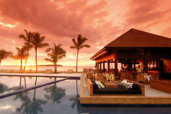Sunset drinks by the resort pool.