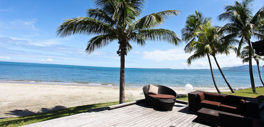 Relaxing by the ocean at beachfront Fiji Beach Resort and Spa by Hilton