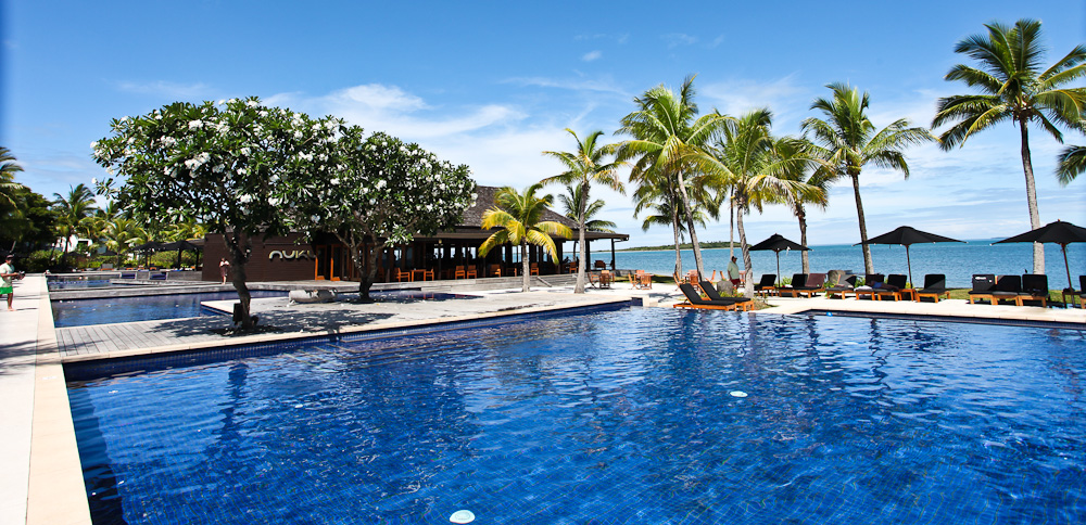 the pool area at fiji beach resort and spa by hilton