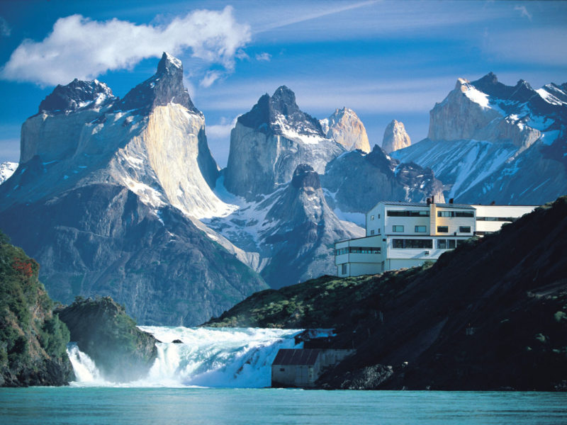 Explora Salto Chico hotel, overlooking Lake Pehoé, the Salto Chico waterfall and the Torres del Paine range.