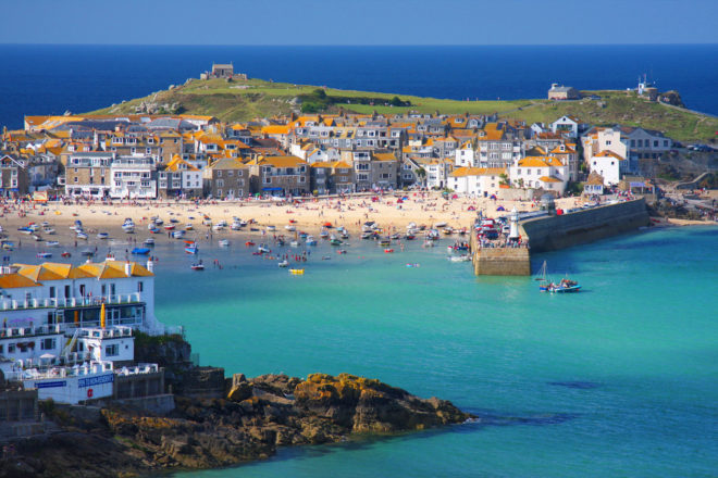 Azure seas surround the beaches of St Ives in Cornwall.