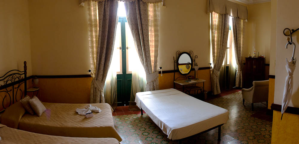 Hotel Raquel's rooms have the spacious, palatial feel to them.