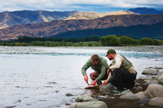 Fishing for trout in Wairau River, Marlborough.