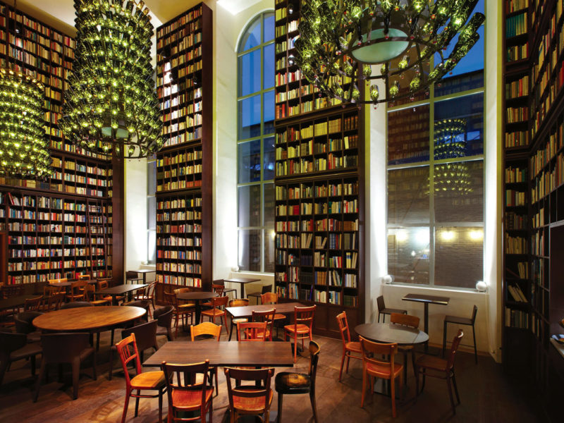 B2's bookish lobby features glass bottle chandeliers.