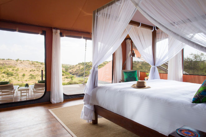 Wake up to the great migration at Mahali Mzuri ecolodge in Kenya.
