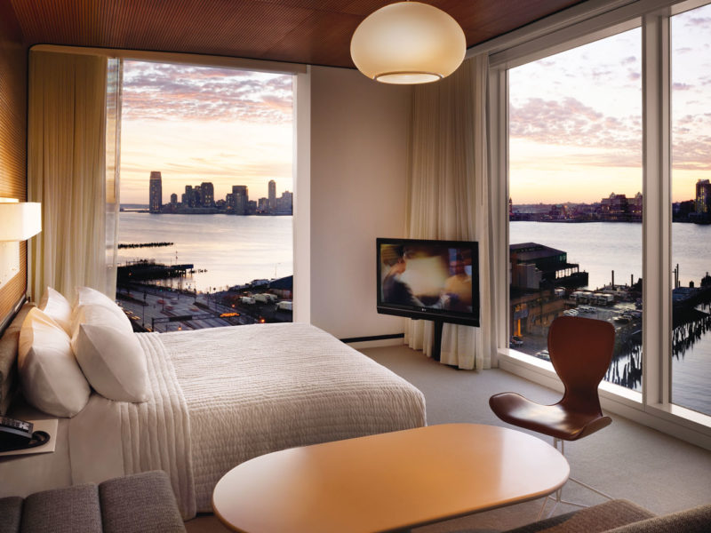 Corner rooms feature floor-to-ceiling, wall-to-wall windows that open.