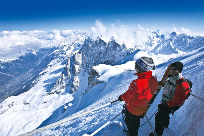 Skiers enjoying the view from Mont Blanc, France.