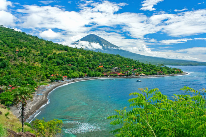 Amed in Bali's northeast, with Agung volcano in the background.