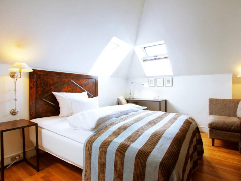Inside a guest suite at Hotel Kong Arthur, Copenhagen.