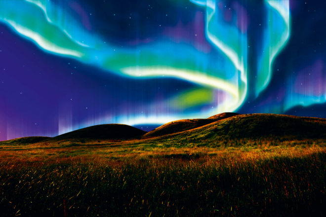 The Northern Lights in the Arctic Circle, ranked #12 in our countdown of '100 Ultimate Travel Experiences of a Lifetime'.