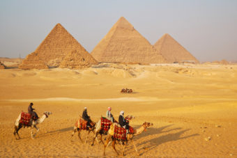 The pyramids in Giza, ranked #21 in our countdown of '100 Ultimate Travel Experiences of a Lifetime'.