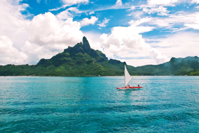 Sailing around Tahiti, ranked #75 in our countdown of '100 Ultimate Travel Experiences of a Lifetime'.