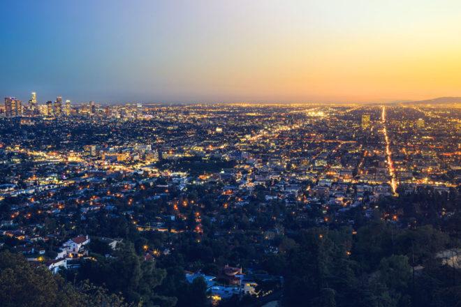 Los Angeles city skyline at dusk.