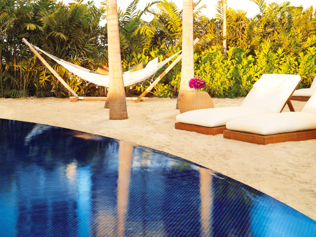 The Sunset Pool's hammocks are only steps from a tiki-luxe bar.