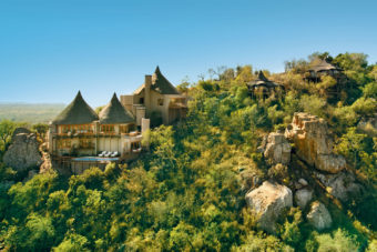 Aerial view of the cliff lodges at Ulusaba Private Game Reserve, overlooking South African wilderness.