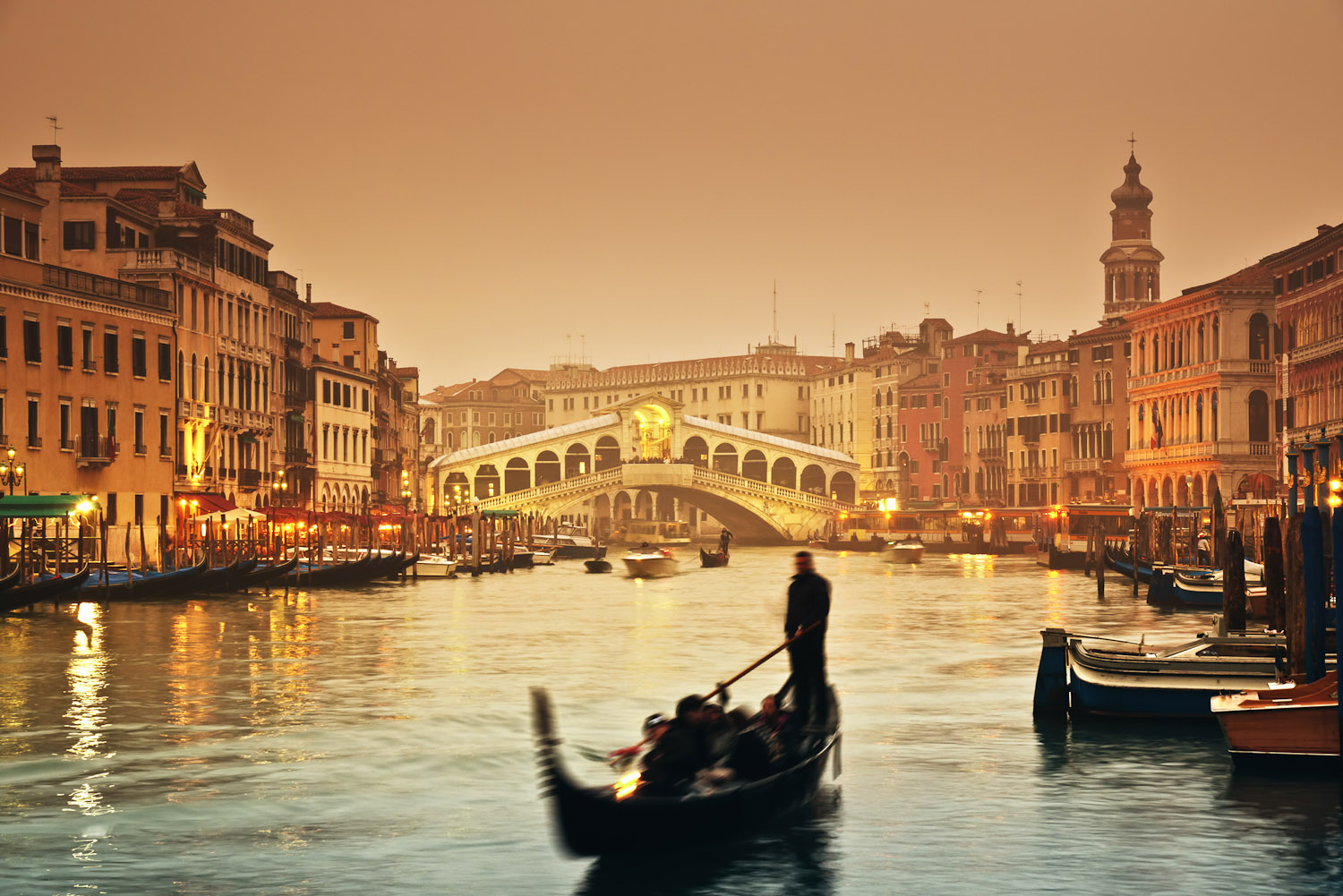 Sunset over the Grand Canal and the famous Rialto Bridge.