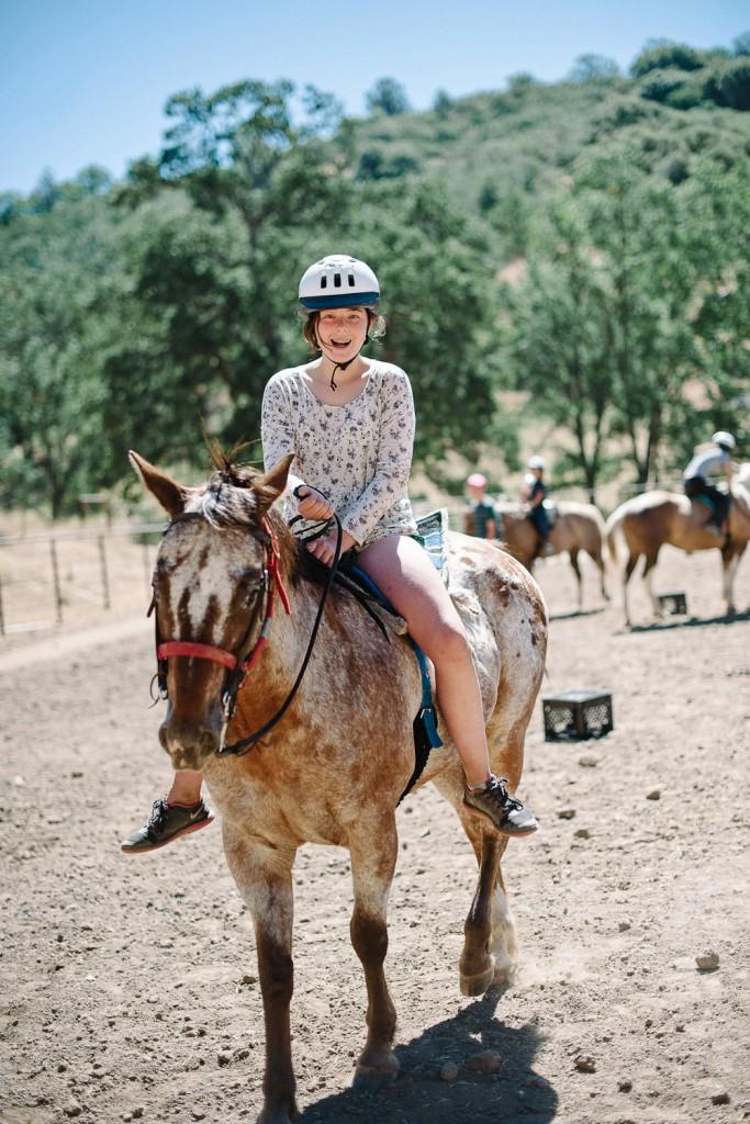 Horse riding at Jameson Ranch Camp, USA.