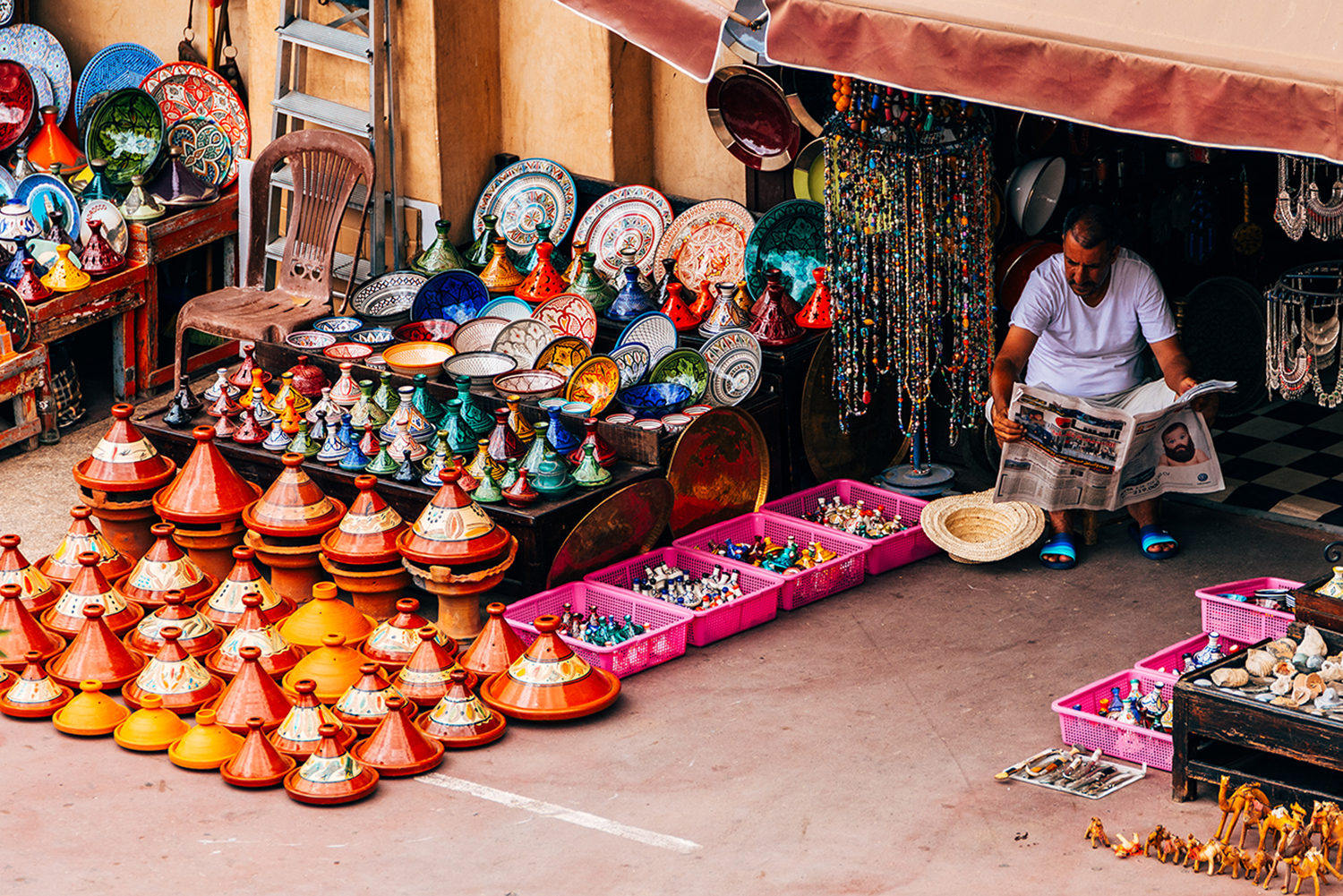 Street vendor selling moroccan handicrafts at Marrakech Medina