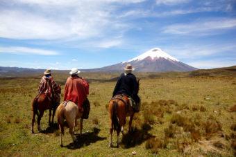 Ecuadorian chagras (cowboys) pause to admire the Andean landscape.