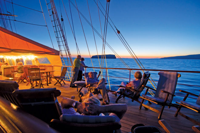 Guests enjoying sunset on board Lindblad's National Geographic Orion.