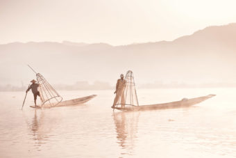 First light hits Inle Lake and the cone-fishermen start their working day.
