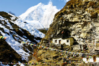 Manaslu peak stands at 8163 metres, a small Buddhist temple sits at its base.