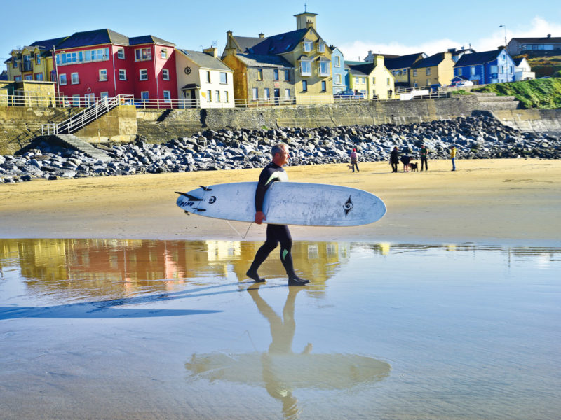 American surfer Shawn Hickey heading out for one of his first rides in Ireland at Lahinch.