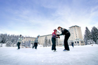 Ice skating on the frozen lake outside Chateau Lake Louise.