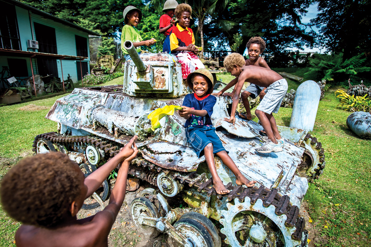 Kids playing at the Kokopo War Museum, Papua New Guinea.
