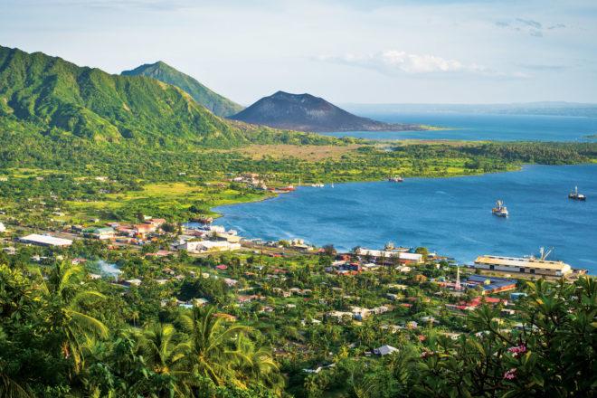 Rabaul withthe dark cone of Mt Tavurvur on the horizon.