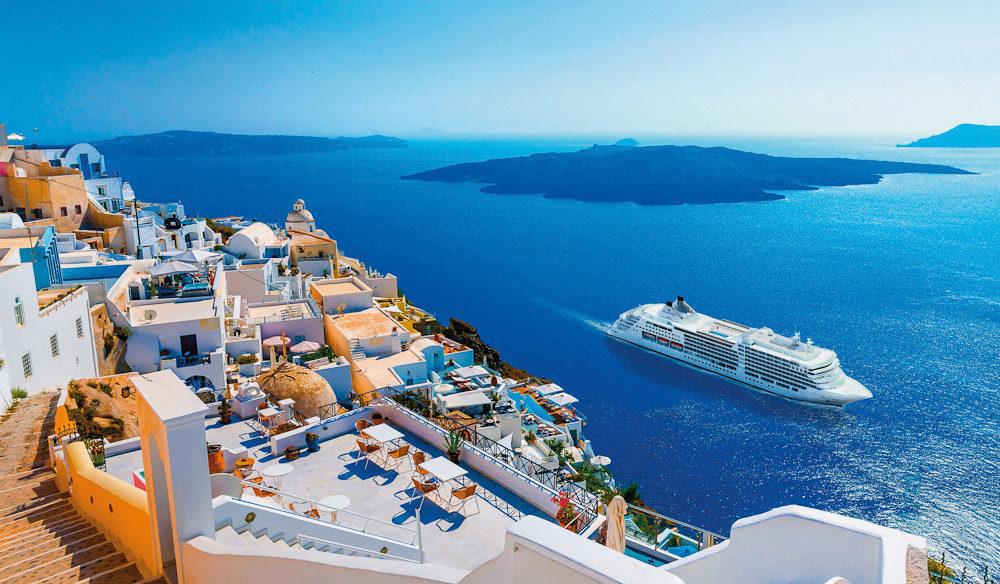 The beautiful Silversea Muse cruising around Santorini