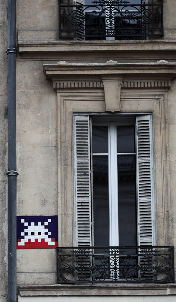 Invader the famous street artists distinctive mark along the streets of Paris