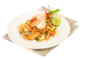 This noodle dish is usually made with rice noodles, eggs, garlic, chili, peanuts, lime, fish sauce, tamarind, and prawns.