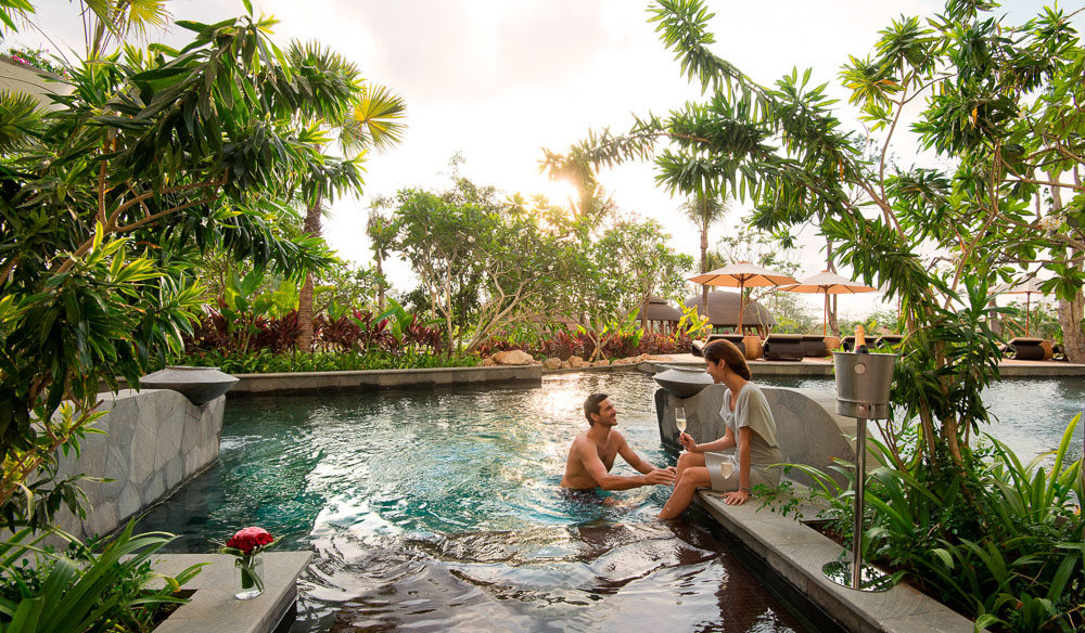 Two people enjoying a romantic escape at RIMBA Jimbaran Bali by AYANA