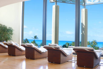 Relaxing chairs looking out onto the stunning view of Waikiki Beach at the Hyatt Regency Waikiki Beach Resort and Spa