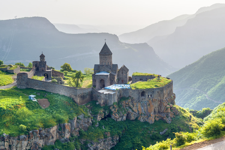 Ancient monastery in setting sun, Tatev, Armenia (photo: Alamy Stock Photo).