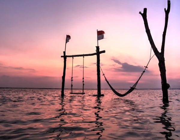 Swing over Bali water